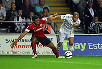 """Pictured: Ashley """"Jazz"""" Richards of Swansea (R). Tuesday 28 August 2012<br /> Re: Capital One Cup game, Swansea City FC v Barnsley at the Liberty Stadium, south Wales."""