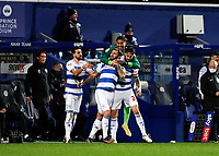 17th February 2021; The Kiyan Prince Foundation Stadium, London, England; English Football League Championship Football, Queen Park Rangers versus Brentford; Charlie Austin of Queens Park Rangers celebrates with his team mates near to the Brentford dugout in front of Brentford Manager Thomas Frank after scoring his his sides 2nd goal in the 76th minute to make it 2-1