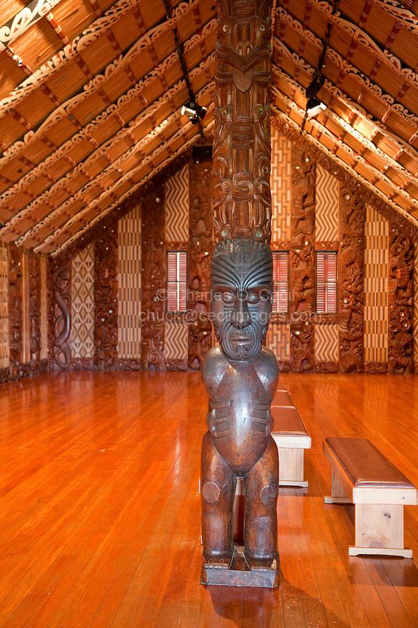 Carved Traditional Maori Figure, called pou-toko-manawa, supporting the ridgepoll of the meeting house, Te Whare Runanga, built 1940, Waitangi Treaty Grounds, Paihia, north island, New Zealand.
