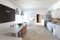 open plan kitchen with dining table