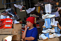 A Palestinian girl sills shoes in the market in Gaza City, Wednesday, Aug. 29, 2007. (FADY ADWAN)
