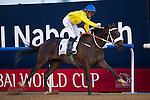 MAR 28,2015:Mubtaahij,ridden by Christophe Soumillon,wins the UAE Derby at Meydan in Dubai,UAE. Kazushi Ishida/ESW/CSM