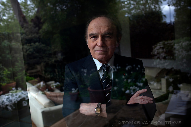 """Samuel Pisar, photographed inside his home in Paris, France on 2 May 2010. (His garden is seen through the reflection.) Pisar is a renowned international lawyer, an author and a Knight of the French Legion of Honor. He was 10 when his native Poland was invaded by Stalin and then Hitler. He survived the Nazi death camps of Majdanek, Auschwitz and Dachau, escaping at the age of 16. At the request of Leonard Bernstein, Pisar wrote the lyrics to Bernstein's Symphony No. 3, the """"Kaddish."""""""