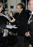 "SIENNA MILLER .Departed after the first preview performance of ""Flare Path"", Haymarket, London, England, UK, 4th March 2011..half length hair up bun signing autographs fans black coat .CAP/CAN.©Can Nguyen/Capital Pictures."