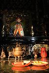 Bao-jhong Yi-min Temple, Kaohsiung -- Taoist god statue on a shrine.
