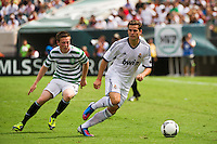 Jose Nacho Fernandez (27) of Real Madrid is marked by Callum McGregor (42) of Celtic F. C.. Real Madrid defeated Celtic F. C. 2-0 during a 2012 Herbalife World Football Challenge match at Lincoln Financial Field in Philadelphia, PA, on August 11, 2012.