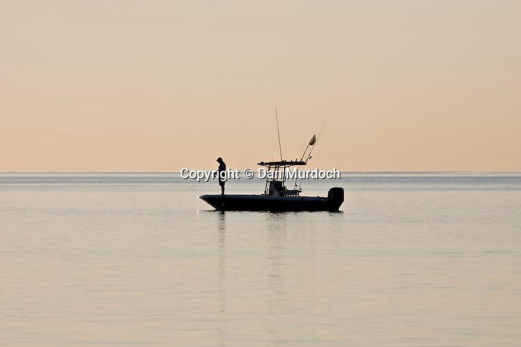 fishing at dawn on a still morning