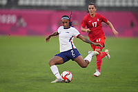 KASHIMA, JAPAN - AUGUST 2: Crystal Dunn #2 of the United States kicks the ball during a game between Canada and USWNT at Kashima Soccer Stadium on August 2, 2021 in Kashima, Japan.