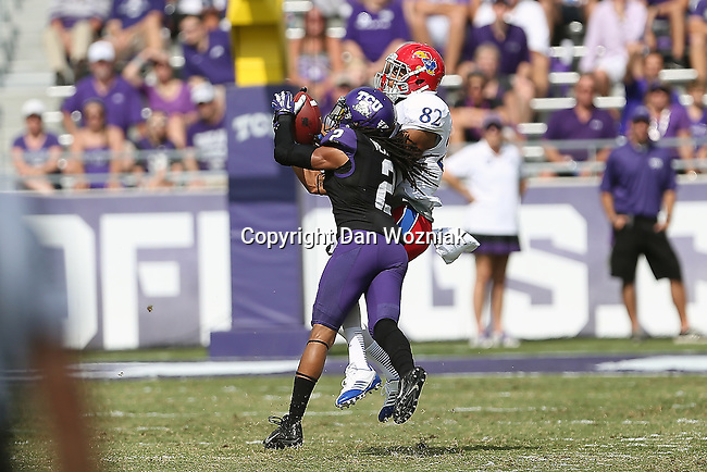 Kansas Jayhawks wide receiver Andrew Turzilli (82) and TCU Horned Frogs cornerback  Jason Verrett (2) in action during the game between the Kansas Jayhawks and the TCU Horned Frogs  at the Amon G. Carter Stadium in Fort Worth, Texas. TCU defeats Kansas 27 to 17.