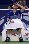 SHANGHAI, CHINA - OCTOBER 12:  Andy Roddick of USA adjust his cap sits on the bench during his match against Philipp Kohlschreiber of Germany during day two of the 2010 Shanghai Rolex Masters at the Shanghai Qi Zhong Tennis Center on October 12, 2010 in Shanghai, China.  (Photo by Victor Fraile/The Power of Sport Images) *** Local Caption *** Andy Roddick