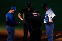 Tampa Tarpons manager David Adams (35) during the lineup exchange with Luis Hurtado (13), home plate umpire Austin Nelson and base umpire Kaleb Devier, before a game against the Dunedin Blue Jays on May 7, 2021 at George M. Steinbrenner Field in Tampa, Florida.  (Mike Janes/Four Seam Images)