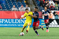 FOXBOROUGH, MA - AUGUST 4: Alex Muyl #19 of Nashville SC brings the ball forward as Wilfrid Kaptoum #5 of New England Revolution defends during a game between Nashville SC and New England Revolution at Gillette Stadium on August 4, 2021 in Foxborough, Massachusetts.