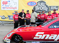Sept. 25, 2011; Ennis, TX, USA: NHRA funny car driver Cruz Pedregon celebrates with his crew after winning the Fall Nationals at the Texas Motorplex. Mandatory Credit: Mark J. Rebilas-