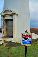 Lighthouse #2 and graffiti marred No Trespassing sign, North Kohala coast, The Big Island of Hawaii