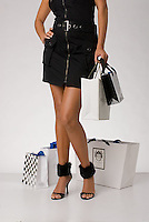 Single woman standing holding shopping bags<br />