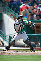Dayton Dragons catcher Yovan Gonzalez #4 during a Midwest League game against the Fort Wayne TinCaps at Parkview Field on August 19, 2012 in Fort Wayne, Indiana.  Dayton defeated Fort Wayne 5-1.  (Mike Janes/Four Seam Images)