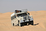Africa, Tunisia, nr. Tembaine. Desert traveller Siegfried and Gernot driving their 1978 Land Rover Series 3 Dormobile through a sandfield close to Tembaine on the eastern edge of the Grand Erg Oriental. --- No releases available, but releases may not be needed for certain uses. Automotive trademarks are the property of the trademark holder, authorization may be needed for some uses.  --- Info: Image belongs to a series of photographs taken on a journey to southern Tunisia in North Africa in October 2010. The trip was undertaken by 10 people driving 5 historic Series Land Rover vehicles from the 1960's and 1970's. Most of the journey's time was spent in the Sahara desert, especially in the area around Douz, Tembaine, Ksar Ghilane on the eastern edge of the Grand Erg Oriental.