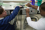 Mae Gammino/ The Warwick Beacon<br /> <br /> Ray, left, receives help from a Trudeau Center social worker while doing his laundry.