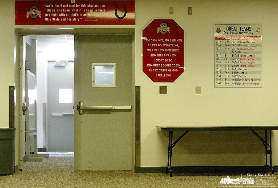 Motivational signs hang near the doors of the Buckeye's locker room for the team to see as they head out on the field before a game at Ohio Stadium Thursday, May 20, 2004 in Columbus, Ohio.