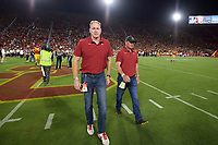 LOS ANGELES, CA - SEPTEMBER 11: Stanford Cardinal honorary captains Adam Keefe and Jimmy Klein walk off the field after the coin-toss before a game between University of Southern California and Stanford Football at Los Angeles Memorial Coliseum on September 11, 2021 in Los Angeles, California.