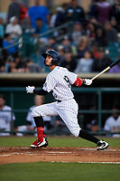 Lancaster JetHawks left fielder Manuel Melendez (19) follows through on his swing during a California League game against the Visalia Rawhide at The Hangar on May 17, 2018 in Lancaster, California. Lancaster defeated Visalia 11-9. (Zachary Lucy/Four Seam Images)
