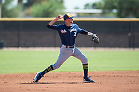 Milwaukee Brewers shortstop Brice Turang (2) throws to first base during an Instructional League game against the San Diego Padres at Peoria Sports Complex on September 21, 2018 in Peoria, Arizona. (Zachary Lucy/Four Seam Images)