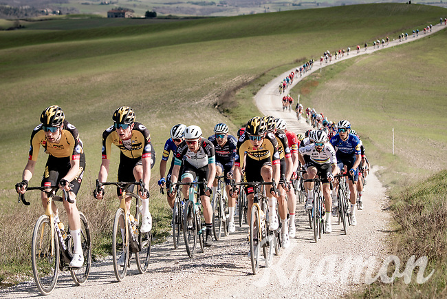 defending champion Wout van Aert (BEL/Jumbo-Visma) escorted at the front of the peloton<br /> <br /> 15th Strade Bianche 2021<br /> ME (1.UWT)<br /> 1 day race from Siena to Siena (ITA/184km)<br /> <br /> ©kramon