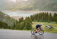 Toms Skujiņš (LVA/Trek - Segafredo) descending the Col du Pré (HC/1748m) towards the Barrage de Roselend in, yet again, grim conditions.<br /> <br /> Stage 9 from Cluses to Tignes (145km)<br /> 108th Tour de France 2021 (2.UWT)<br /> <br /> ©kramon