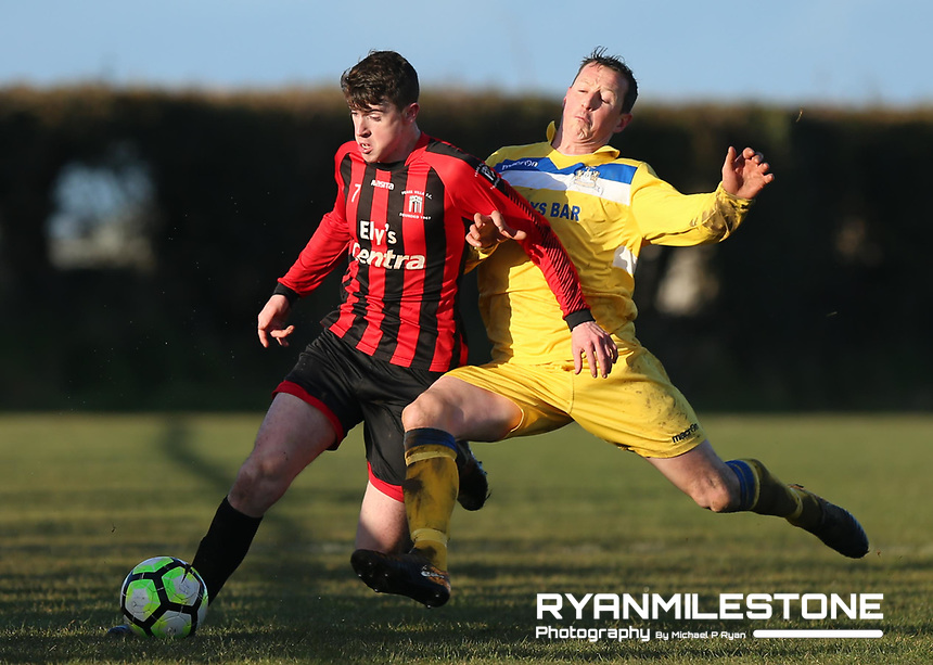 Peake Villa's Michael Wade in action with Aiden Keenan of Thurles during the Munster Junior Cup 5th Round at Tower Grounds, Thurles, Co Tipperary on Sunday 11th February 2018, Photo By Michael P Ryan