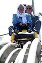 Iraq 2007 .Rowanduz : in a recreation resort, a couple enjoying time.<br /> Irak 2007.Rowanduz: dans un parc de loisirs, un couple sur un manège