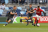 SAINT PAUL, MN - MAY 15: Franco Jara #29 of FC Dallas and Wil Trapp #20 of Minnesota United FC chase the ball during a game between FC Dallas and Minnesota United FC at Allianz Field on May 15, 2021 in Saint Paul, Minnesota.