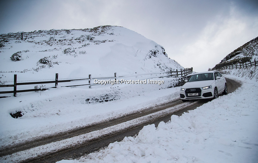 17/01/18<br /> <br /> An Audi makes its way over Mam Tor in the Derbyshire Peak District near Castleton..<br /> <br /> All Rights Reserved F Stop Press Ltd. +44 (0)1335 344240 +44 (0)7765 242650  www.fstoppress.com
