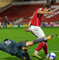 21st November 2020, Oakwell Stadium, Barnsley, Yorkshire, England; English Football League Championship Football, Barnsley FC versus Nottingham Forest; Callum Brittain of Barnsley beats Yuri Ribeiro of Nottingham Forrest