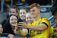 Hurricanes' Ruben Love poses for a selfy with fans after the Super Rugby Aotearoa match between the Hurricanes and Crusaders at Sky Stadium in Wellington, New Zealand on Sunday, 11 April 2020. Photo: Dave Lintott / lintottphoto.co.nz