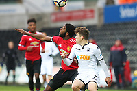 Sunday 18 March 2018<br /> Pictured:  Ro Shaun Williams of Manchester United and Daniel James of Swansea City contend for the ball<br /> Re: Swansea City v Manchester United U23s in the Premier League 2 at The Liberty Stadium on March 18, 2018 in Swansea, Wales.