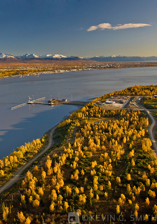 Aerial photo of loading dock and port at Point Mackenzie on the opposite side of Knik Arm from Anchorage with the Chugach Mountains in the background, Fall, Southcentral Alaska, USA.