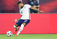 NASHVILLE, TN - SEPTEMBER 5: DeAndre Yedlin #22 of the United States crosses a ball into the box during a game between Canada and USMNT at Nissan Stadium on September 5, 2021 in Nashville, Tennessee.
