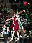Denver Pioneers forward Justin Coughlin (12) and North Texas Mean Green forward Tony Mitchell (13) in action during the game between the Denver Pioneers and the University of North Texas Mean Green at the North Texas Coliseum,the Super Pit, in Denton, Texas. UNT defeated Denver 75 to 74 in overtime.