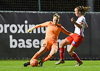 goalkeeper Lowiese Seynhave (1) of Anderlecht pictured shooting the ball away in front of Geena Lisa Buyle (13) of Zulte-Waregem during a female soccer game between RSC Anderlecht Dames and SV Zulte Waregem on the 10 th matchday of the 2020 - 2021 season of Belgian Womens Super League , friday 18 th of December 2020  in Tubize , Belgium . PHOTO SPORTPIX.BE | SPP | DAVID CATRY