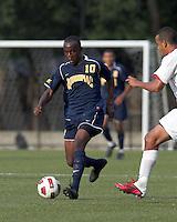 Quinnipiac University forward Remere Warner (10) brings the ball forward. Boston College defeated Quinnipiac, 5-0, at Newton Soccer Field, September 1, 2011.