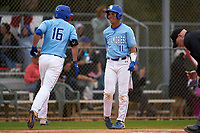 Indiana State Sycamores Diego Gines (11) congratulates Brandt Nowaskie (16) after a home run during a game against the Dartmouth Big Green on February 21, 2020 at North Charlotte Regional Park in Port Charlotte, Florida.  Indiana State defeated Dartmouth 1-0.  (Mike Janes/Four Seam Images)