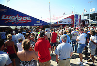 Jul, 8, 2011; Joliet, IL, USA: Fans surround the pit area of NHRA top fuel dragster driver Shawn Langdon during qualifying for the Route 66 Nationals at Route 66 Raceway. Mandatory Credit: Mark J. Rebilas-