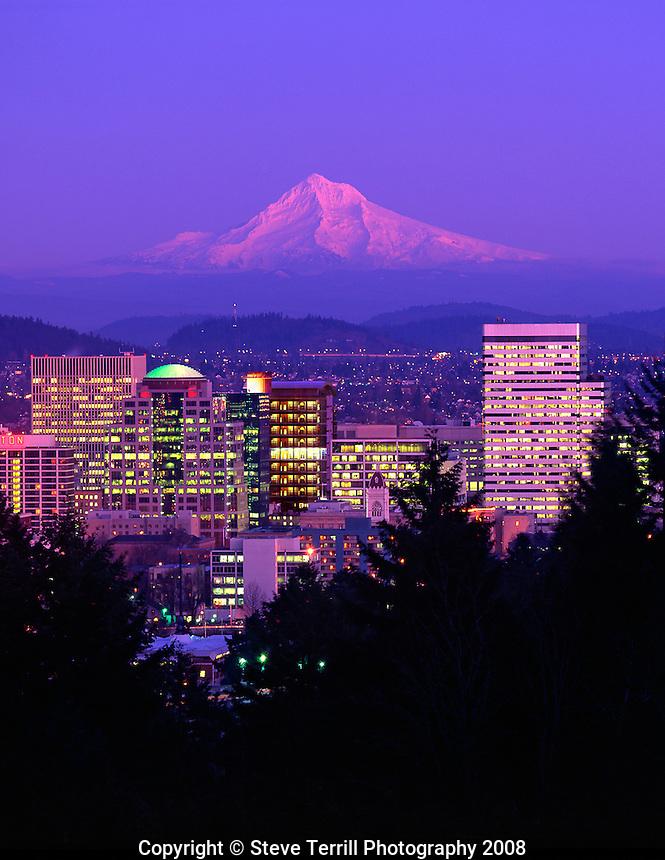 USA, Oregon, Portland skyline & Mt. Hood in alpenglow viewed from Washington Park in the West Hills of Portland.