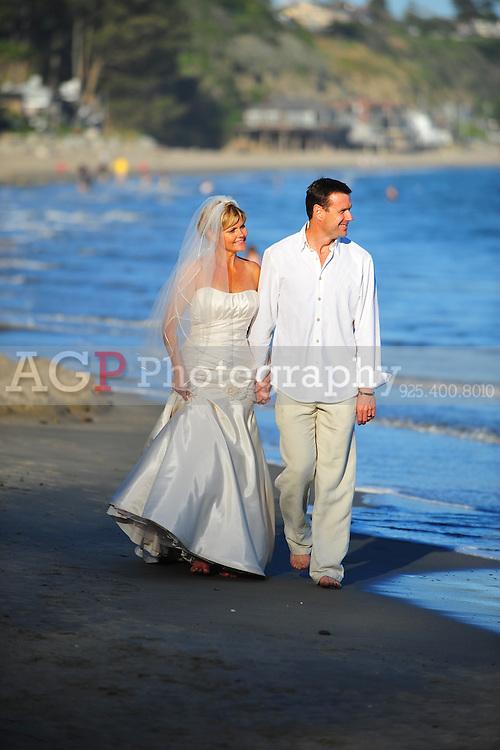 Kelli and Doug on New Brighton Beach on their wedding day May 29, 2010. (Photo by Alan Greth)
