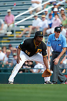 Pittsburgh Pirates first baseman Josh Bell (55) gets in position as umpire John Tumpane looks on during a Spring Training game against the Toronto Blue Jays  on March 3, 2016 at McKechnie Field in Bradenton, Florida.  Toronto defeated Pittsburgh 10-8.  (Mike Janes/Four Seam Images)