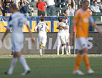 LA Galaxy players defender Todd Dunivant (2) and midfielder Alex Cazumba (88) advance over to congratulate teammate rookie forward Tristan Bowen (17) after scoring a goal. The LA Galaxy defeated the Houston Dynamo 4-1 at Home Depot Center stadium in Carson, California on Saturday evening June 5, 2010..