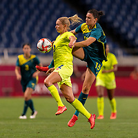 TOKYO, JAPAN - JULY 24: Jonna Andersson #2 of Sweden fights for the ball with Emily Gielnik #15 of Australia during a game between Australia and Sweden at Saitama Stadium on July 24, 2021 in Tokyo, Japan.