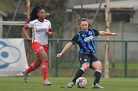 Jody Vangheluwe (22) of Club Brugge and Esther Buabadi (24) of Zulte-Waregem  pictured during a female soccer game between SV Zulte - Waregem and Club Brugge YLA on the 13 th matchday of the 2020 - 2021 season of Belgian Scooore Womens Super League , saturday 6 th of February 2021  in Zulte , Belgium . PHOTO SPORTPIX.BE | SPP | DIRK VUYLSTEKE