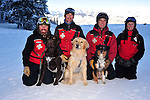 Crested Butte ski patrol and their three avalanche rescue dogs.  Shawn Williams and his chocolate lab, Ziggy.  Russ Reycraft and his blonde lab, Betty.  Zach Springer and Emma. And their patrol colleague, Robin Wehmeyer.