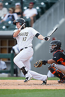 Jason Coats (17) of the Charlotte Knights follows through on his swing against the Norfolk Tides at BB&T BallPark on June 7, 2015 in Charlotte, North Carolina.  The Tides defeated the Knights 4-1.  (Brian Westerholt/Four Seam Images)